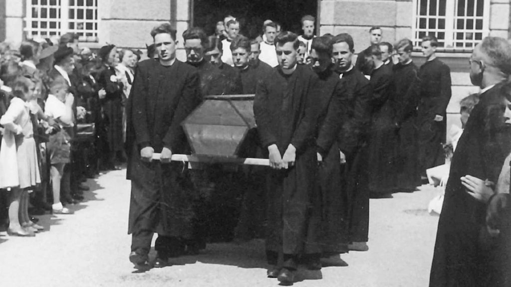 Paul Andrews SJ is the coffin-bearer at the front on the right of this photo.
